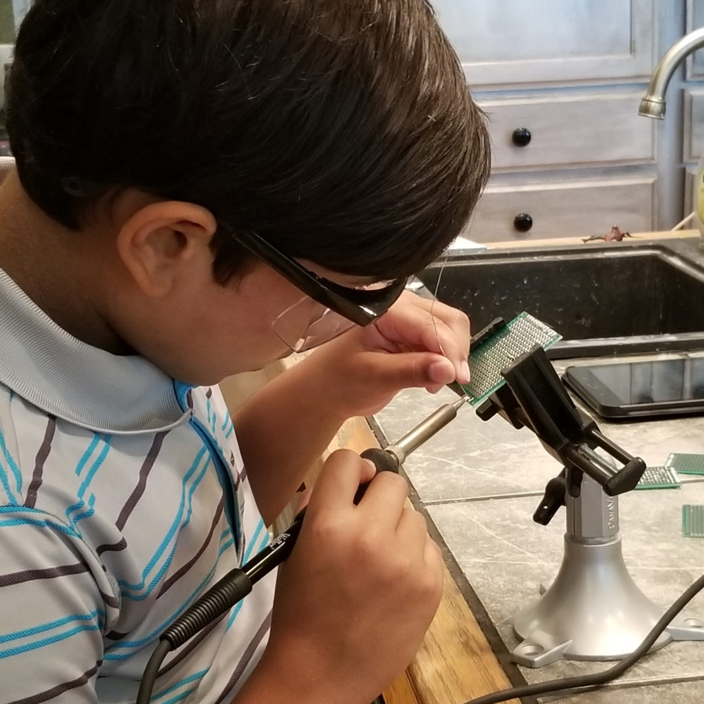 student learning to solder